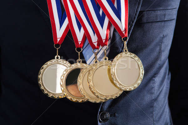 Businessman Wearing Gold Medals Stock photo © AndreyPopov