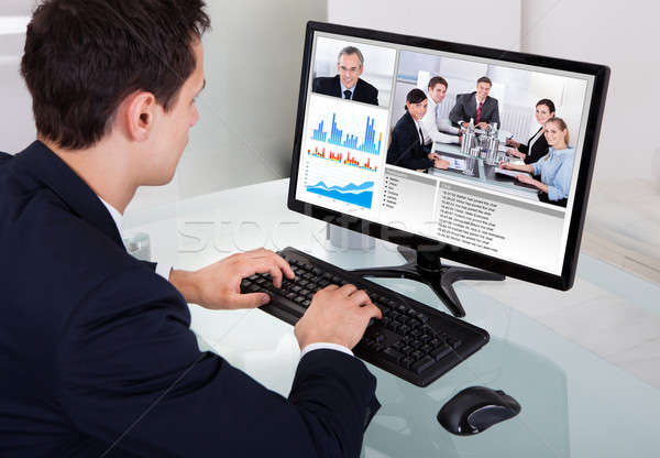 Businessman Video Conferencing With Team In Office Stock photo © AndreyPopov