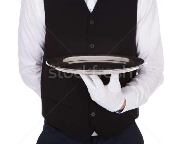 Pincér tart üres tálca fehér étel Stock fotó © AndreyPopov