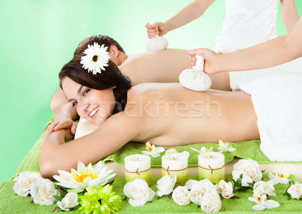 Couple Receiving Massage With Herbal Compress Balls Stock photo © AndreyPopov