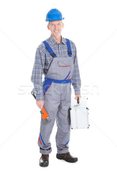 Male Worker Holding Toolbox And Wrench Stock photo © AndreyPopov