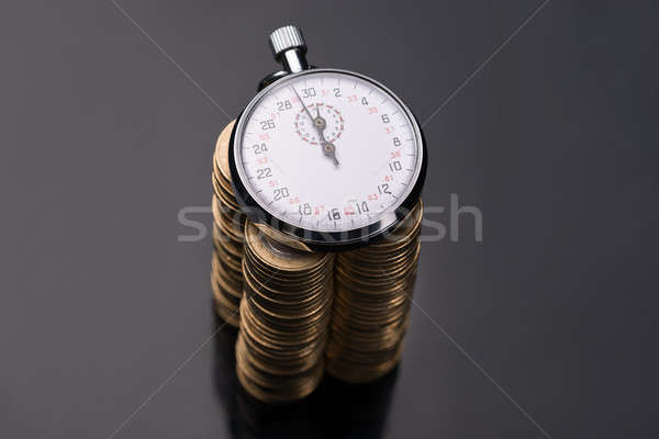 Stopwatch on stack of euro coins Stock photo © AndreyPopov