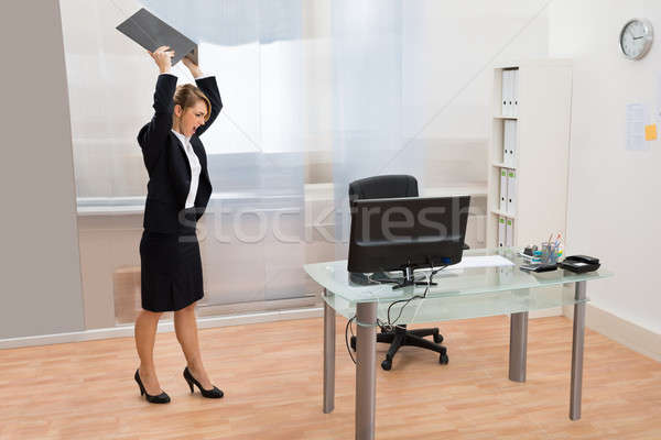 Angry Businesswoman Throwing Laptop Stock photo © AndreyPopov
