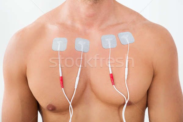 Man With Electrodes On Chest Stock photo © AndreyPopov