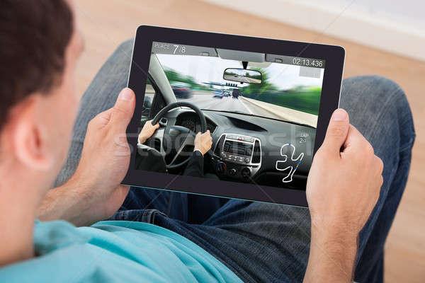 человека играет автомобилей игры цифровой таблетка Сток-фото © AndreyPopov