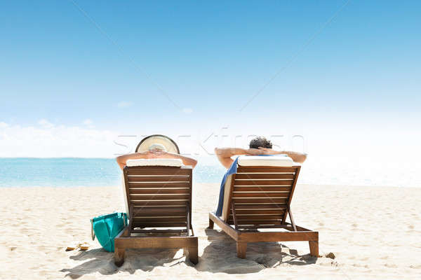 Couple Lying On Lounge Chair Stock photo © AndreyPopov
