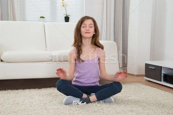 Girl Doing Meditation Stock photo © AndreyPopov