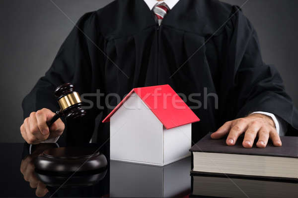 Judge Holding Gavel With House Model Stock photo © AndreyPopov