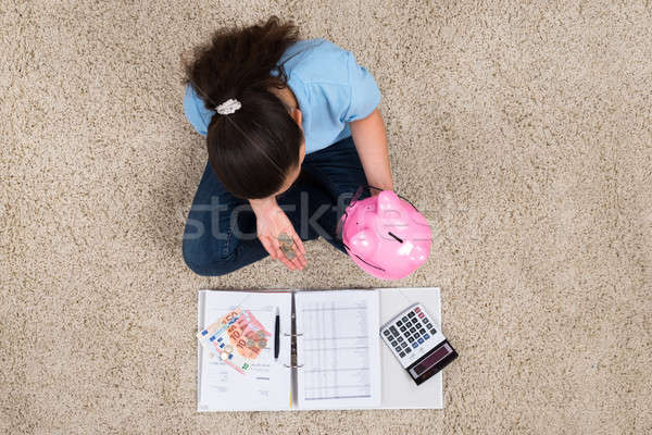 Woman Inserting Coin In Piggybank Stock photo © AndreyPopov
