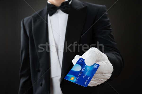 Garçom cartão de crédito cinza homem servidor Foto stock © AndreyPopov