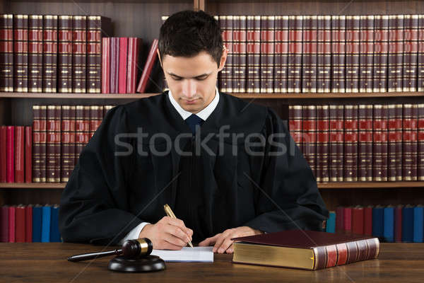 Judge Making Legal Documents At Desk Stock photo © AndreyPopov