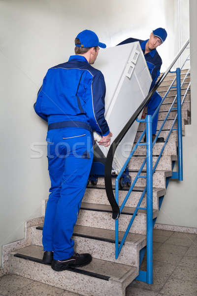 Movers Carrying Refrigerator On Steps Stock photo © AndreyPopov