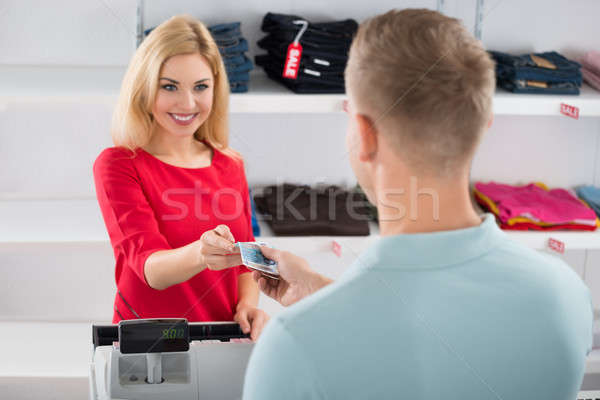 Saleswoman Receiving Payment From Male Customer Stock photo © AndreyPopov