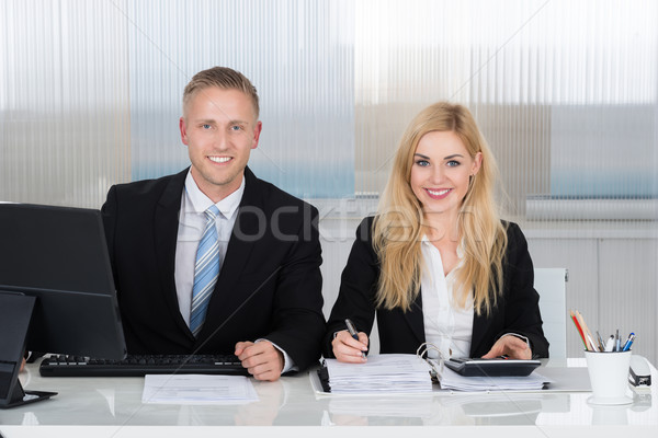 Smiling Accountants Calculating Finance At Desk In Office Stock photo © AndreyPopov