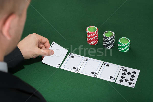 Poker Player Playing Cards On Green Table Stock photo © AndreyPopov