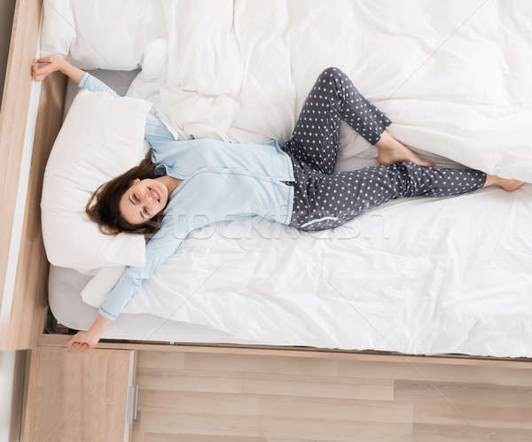 Woman Waking Up On Her Bed Stock photo © AndreyPopov