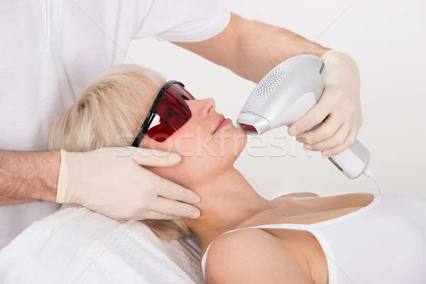 Woman Receiving Laser Epilation Treatment At Spa Stock photo © AndreyPopov