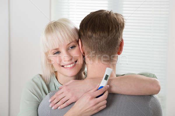Mulher teste de gravidez homem feliz mulher jovem Foto stock © AndreyPopov