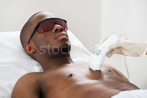 Therapist Giving Laser Epilation On Man's Chest Stock photo © AndreyPopov