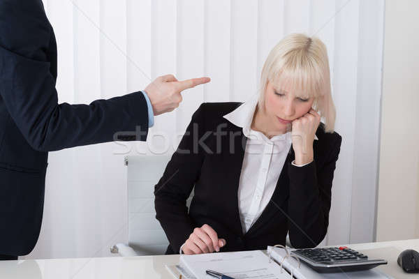 Man Bullying Woman In Office Stock photo © AndreyPopov