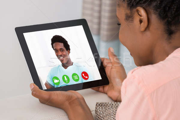 Young Woman Video Conferencing With Man Stock photo © AndreyPopov