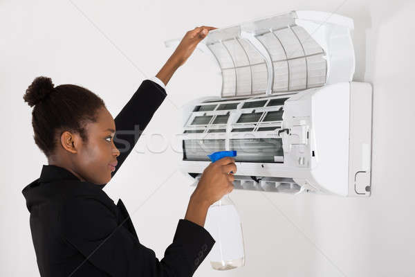 Businesswoman Cleaning Air Conditioner Stock photo © AndreyPopov