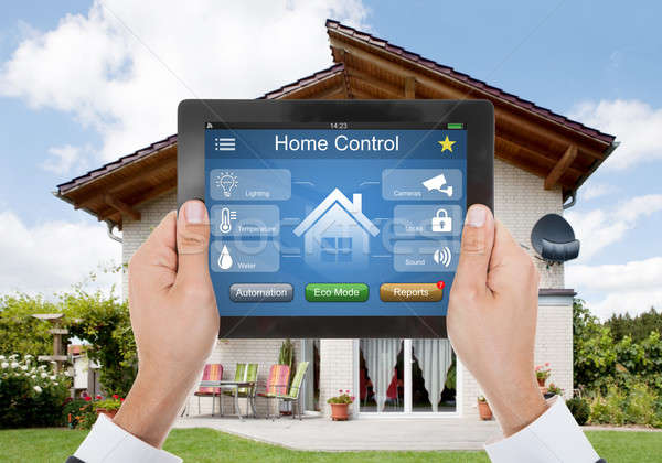 Person Hand Holding Digital Tablet With Home Control System Stock photo © AndreyPopov