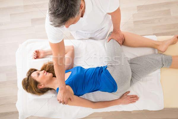 Massaggiatore massaggio donna donna matura spa uomo Foto d'archivio © AndreyPopov
