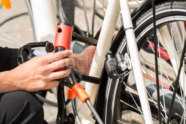 Businesswoman's Hand Locking Up Her Bicycle Stock photo © AndreyPopov