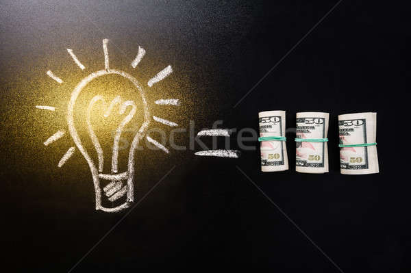 Equal Sign Between Light Bulb And Currency Note Stock photo © AndreyPopov