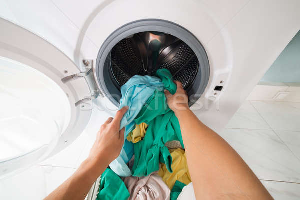 Person Putting Clothes In Washing Machine Stock photo © AndreyPopov