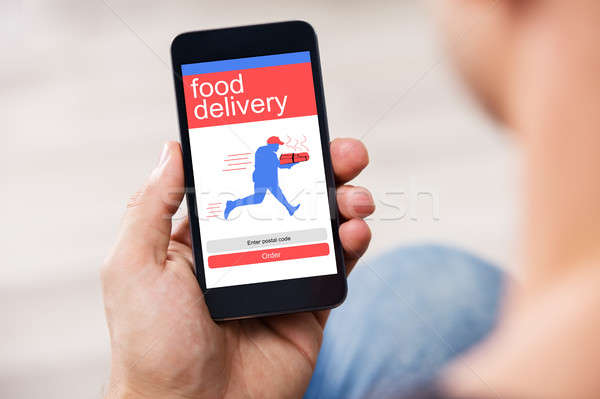 Smart Phone Showing Food Delivery Application On A Screen Stock photo © AndreyPopov