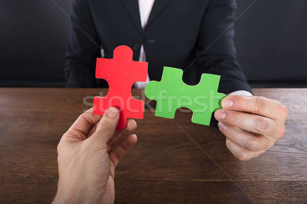 Two Businessmen Joining Jigsaw Pieces Stock photo © AndreyPopov