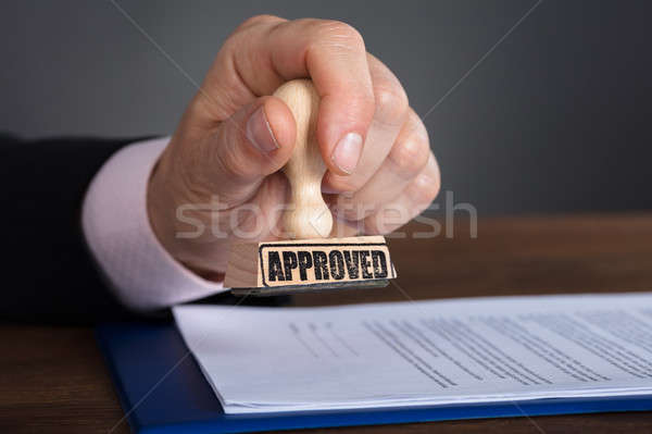 Person's Hand Stamping On Approved Document Stock photo © AndreyPopov