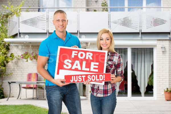 Stock photo: Young Couple Selling Their House