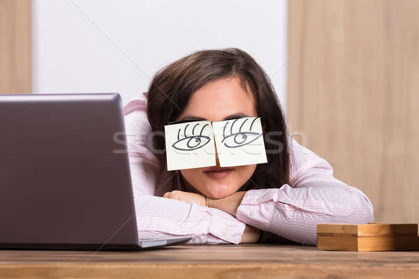 Sleeping Businesswoman Covering His Eyes With The Sticky Notes Stock photo © AndreyPopov