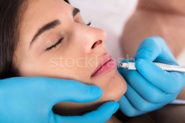 Stock photo: Cosmetologist Applying Permanent Make Up On Lips