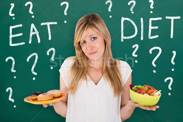 Genç kadın sağlıklı sağlıksız gıda karışık Stok fotoğraf © AndreyPopov