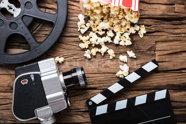 Movie Camera With Film Reel  Clapper Board And Popcorn Stock photo © AndreyPopov
