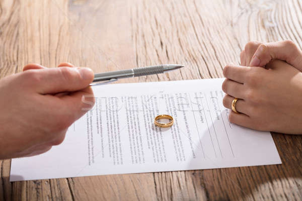 Couple Signing Divorce Paper Stock photo © AndreyPopov