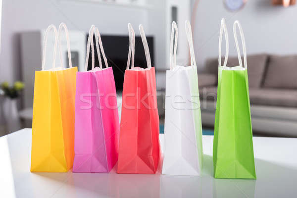 Multi Colored Shopping Bags On Desk Stock photo © AndreyPopov
