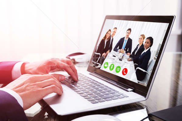 Close-up Of A Businessperson's Hand Video Conferencing On Laptop Stock photo © AndreyPopov
