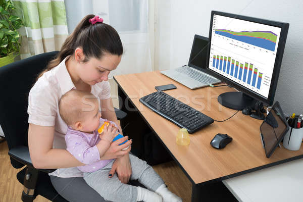 Woman Analyzing Graph On Computer Stock photo © AndreyPopov