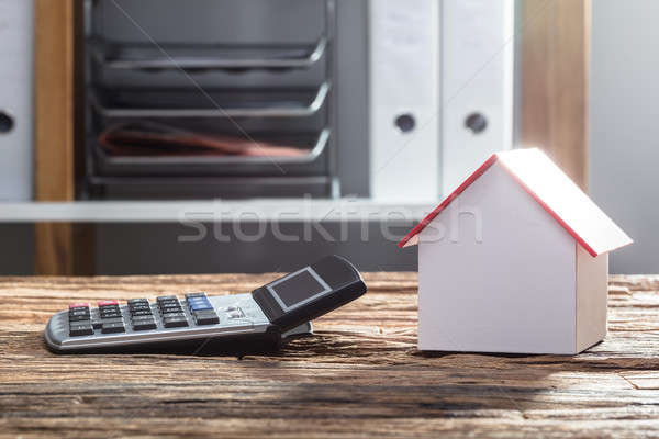 Close-up Of House Model And Calculator Stock photo © AndreyPopov