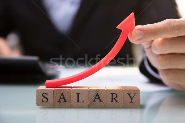 Empresario rojo flecha salario bloques Foto stock © AndreyPopov