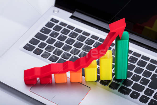 Close-up Of Graph And Arrow Sign Showing Upward Direction Stock photo © AndreyPopov