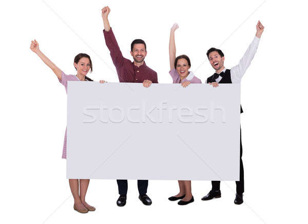 Excited Staff Holding Billboard Raising Their Arms Stock photo © AndreyPopov
