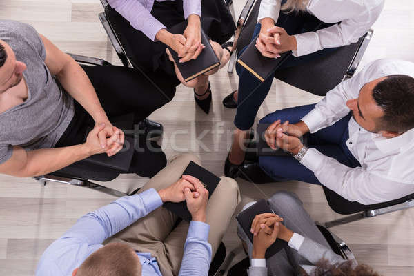 Groep mensen bidden samen mensen heilig Stockfoto © AndreyPopov