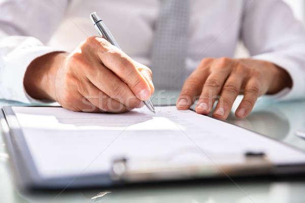 üzletember tömés szerződés űrlap kéz toll Stock fotó © AndreyPopov