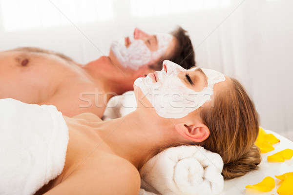 Man and woman in face masks Stock photo © AndreyPopov